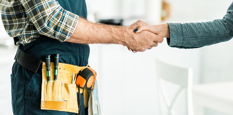 Handyman shaking hands with cusotmer