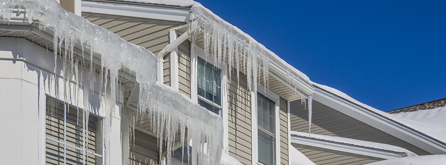 Ice dam and icicles on home