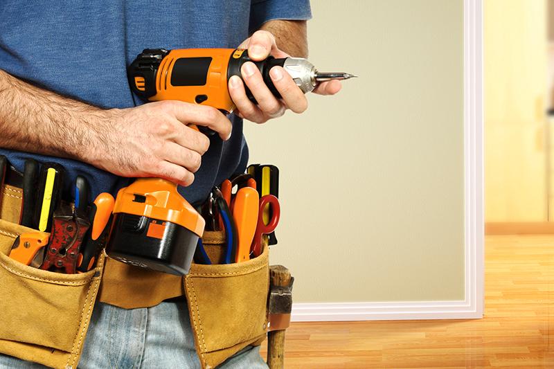Man holding drill