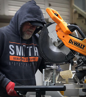 Man sawing wood