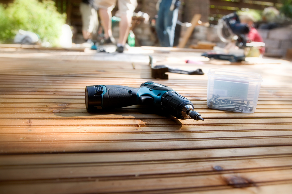 Close-up of a drill for a deck installation
