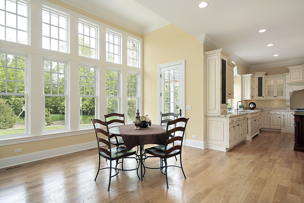 Dining area with soundproof windows that let natural light in