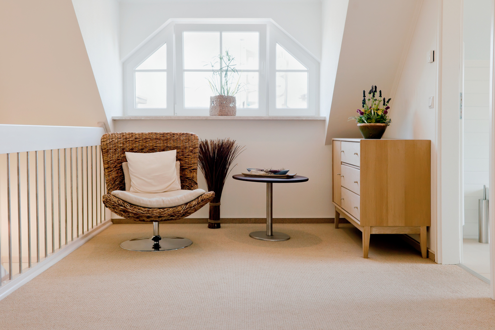 Modern home office interior of a reading corner with a chair and small table