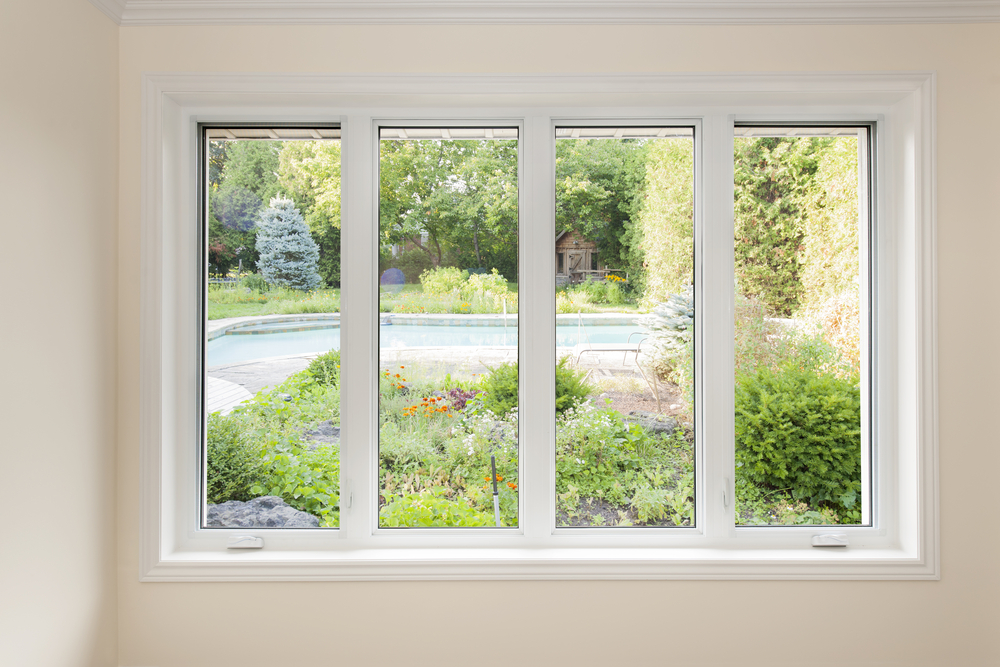 Window with a view of a summer backyard