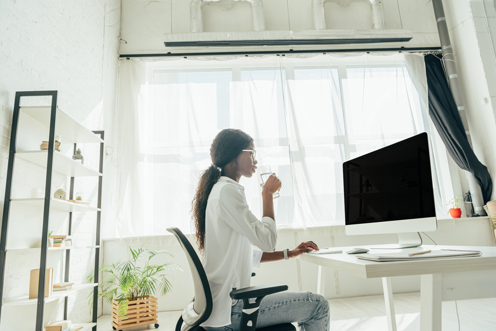 Woman working in a home office with natural light