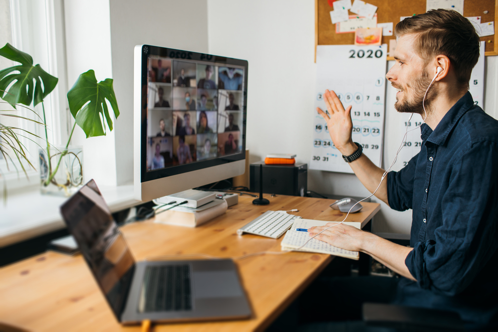 Young man holding a meeting on Zoom in a home office